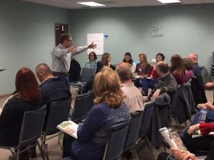 Alan teaching his Bible study group